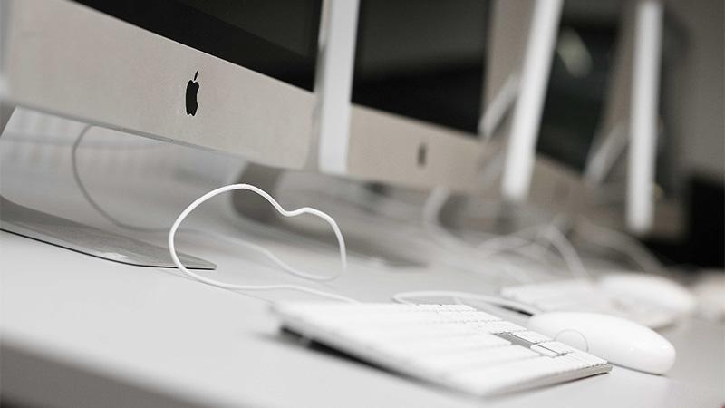 Row of Apple iMac computers