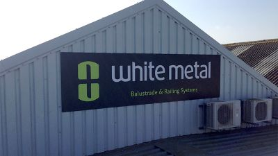 White Metal Company Building Signage